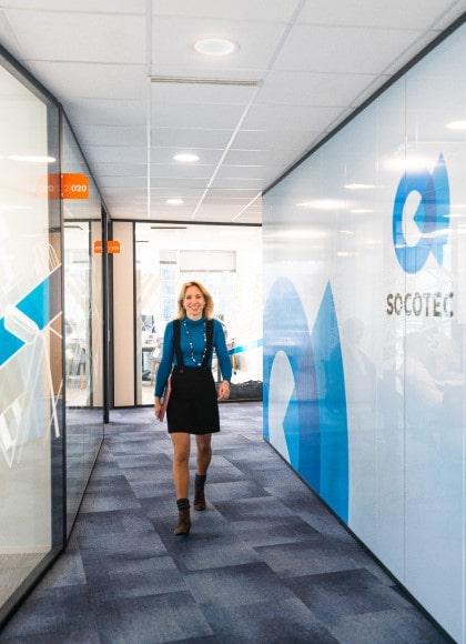 visual of a socotec expert walking at the headquarters